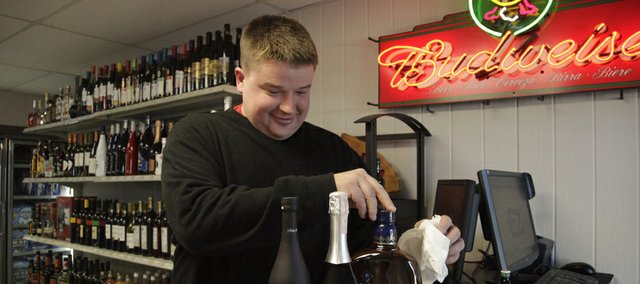 Scott Bronoski, of Lawrence, opened Overbrook Spirits on Monday, lifting almost 125 years of the town's lifelong prohibition on packaged liquor sales. Overbrook had been one of five communities statewide to approve laws maintaining the prohibition until a public vote this past November repealed it.