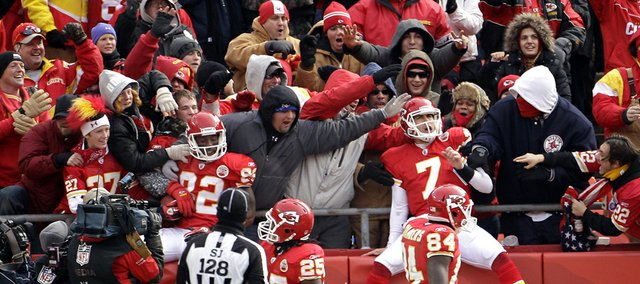 Kansas City Chiefs wide receiver Dwayne Bowe (82) and quarterback Matt Cassel (7) celebrate in the stands after Bowe scored a touchdown during the second quarter against Tennessee. The Chiefs beat the Titans, 34-14, Sunday in Kansas City, Mo.