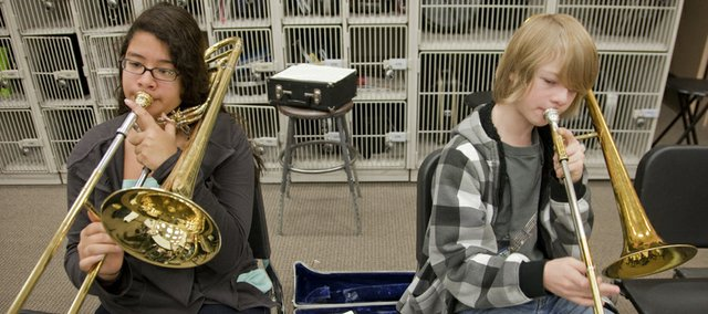 Gabby Ramos, left, and Kyle Berkley, both South Junior High eighth-graders, play their trombones during band rehearsals Dec. 16. All district eighth-graders will move into high school next year as freshmen become part of the high school campuses and junior highs change into middle schools.