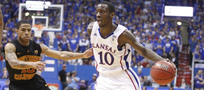 Kansas guard Tyshawn Taylor drives against USC guard Maurice Jones during the second half, Saturday, Dec. 18, 2010 at Allen Fieldhouse.