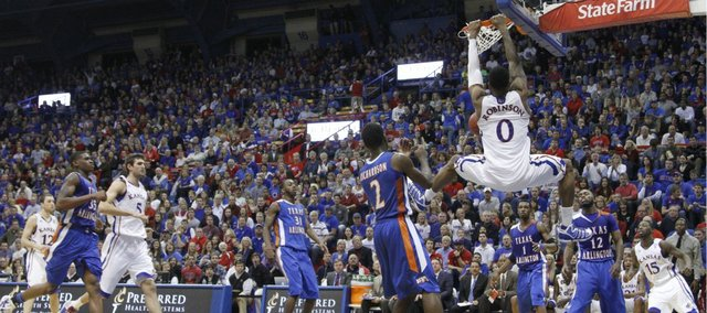 Kansas forward Thomas Robinson delivers a dunk before the UT Arlington defense during the second half, Wednesday, Dec. 29, 2010 at Allen Fieldhouse.