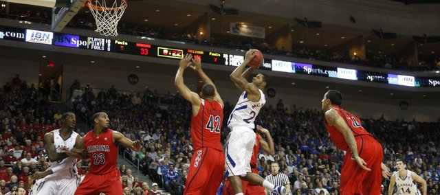 Kansas forward Marcus Morris turns for a shot over Arizona forward Jamelle Horne during the first half of the Las Vegas Invitational, Saturday, Nov. 27, at the Orleans Arena.