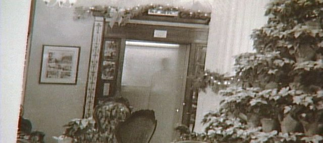 This photo, apparently showing a shadowy figure in an elevator at the Eldridge Hotel, 701 Mass., is among the evidence that, according to some believers, proves a ghost lives in the building.