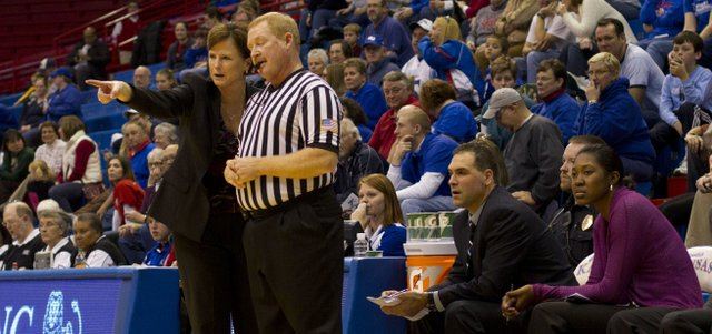 Kansas head coach Bonnie Henrickson talks to an official about a call during Kansas' game against SIU Edwardsville  Sunday, Dec. 19, 2010 at Allen Fieldhouse. The Jayhawks routed the Cougars, 91-52.