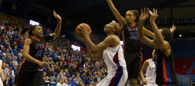 Kansas forward Carolyn Davis looks to the basket as three UT-Arlington defenders collapse around her Thursday, December 30, 2010 at Allen Fieldhouse. Davis led all scorers with 26 points as the Jayhawks defeated the Mavericks, 80-57, and improved their overall record to 12-1 for the season.