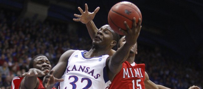 Kansas guard Josh Selby cuts to the bucket past Miami (Ohio) University defenders Julian Mavunga (4) and Orlando Williams (15) during the second half, Sunday, Jan. 2, 2011 at Allen Fieldhouse.
