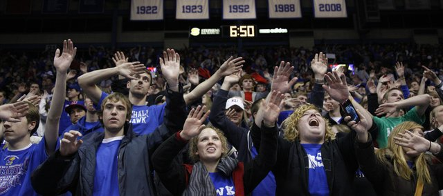 The south end student section waves the wheat following the Jayhawks' 83-56 win over Miami (Ohio) University, Sunday, Jan. 2, 2011 at Allen Fieldhouse.