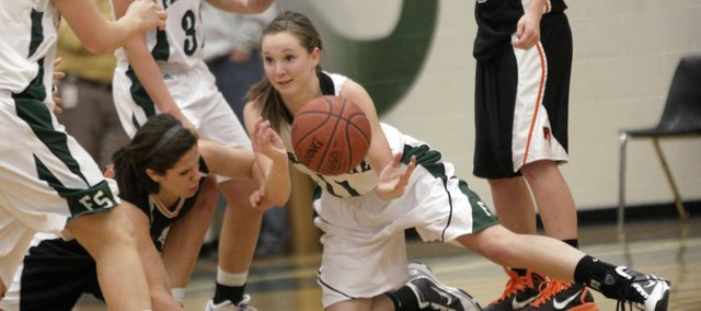 Free State's Kennedy Kirkpatrick dives for a loose ball in the second half against the Platte County Pirates on Tuesday, January 4, 2011 at Free State High School.