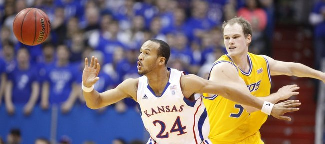 Kansas guard Travis Releford knocks the ball away for a steal from UMKC forward Max Rockmann during the first half on Wednesday, Jan. 5, 2011 at Allen Fieldhouse.