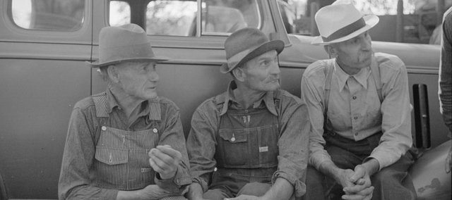 "The Farmer's Almanac offers the answers to such vexing questions as the best days to start logging, the best days to castrate livestock or make sauerkraut. All the while being ""useful, with a pleasant degree of humor."" These farmers were photographed in the 1930s in Oskaloosa."