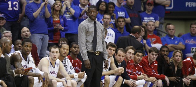 Mario Little, who is suspended, stands to watch the action from the bench during the first half, Wednesday, Dec. 29, 2010 at Allen Fieldhouse.