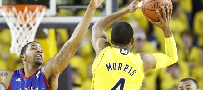 Kansas forward Markieff Morris defends as Michigan guard Darius Morris redirects his pass during the first half on Sunday, Jan. 9, 2011 at Crisler Arena.