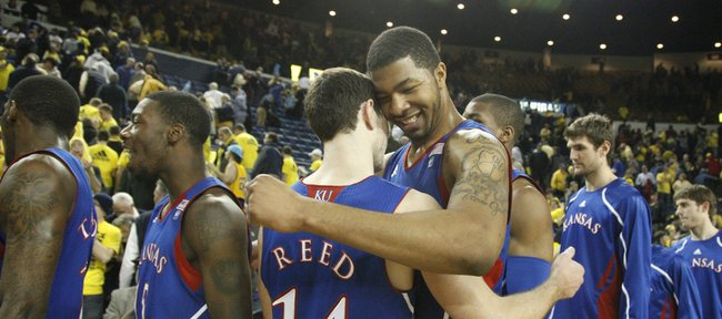 Kansas forward Markieff Morris hugs teammate Tyrel Reed (14) after holding off Michigan for a 67-60 overtime victory on Sunday, Jan. 9, 2010 in Ann Arbor, Mich. Morris had 13 points and 11 rebounds against the Wolverines.