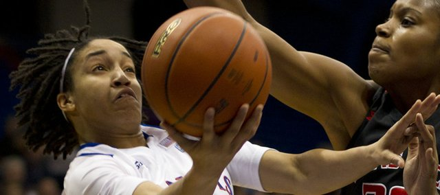 Kansas guard Keena Mays attempts to get a shot off around Texas Tech center Kierra Mallard (20) during Kansas' game against Texas Tech Saturday in Allen Fieldhouse.