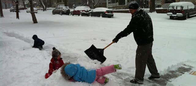 Children around Lawrence and across northeast Kansas were left to play in the snow Monday, Jan. 10, 2011, after several inches of snow fell and led school districts to call off Monday classes. About three inches of snow had fallen by Monday morning with snow showers projected for the rest of the day.