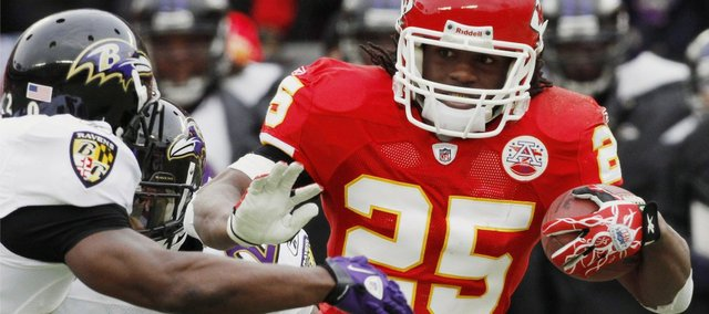 Kansas City Chiefs running back Jamaal Charles (25) runs past Baltimore Ravens safety Ed Reed to score a 41-yard touchdown in the Chiefs' playoff loss on Sunday in Kansas City, Mo. Charles was one the highlights of the Chiefs' season.