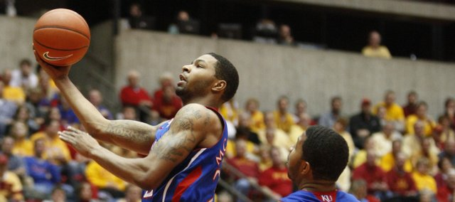 Kansas forward Marcus Morris gets a bucket as he's fouled by Iowa State forward Melvin Ejim during the first half on Wednesday, Jan. 12, 2011 at Hilton Coliseum in Ames, Iowa.
