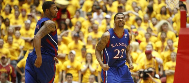 Kansas forward Marcus Morris (22) clenches his fists as he and twin brother Markieff head back on defense after a Jayhawk bucket against Iowa State during the second half. Marcus had 33 points and Markieff 17 in the Jayhawks' 84-79 victory Wednesday in Ames, Iowa.