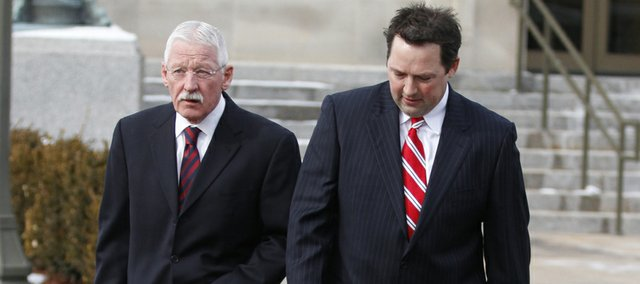 Former University of Kansas official Rodney Jones, right, leaves the U.S. Federal Courthouse in Wichita, Kan., on Friday, Jan. 14, 2011, with his attorney, Gerald Handley, after appearing in court, accused of conspiring to steal more than $2 million in tickets to athletic events.