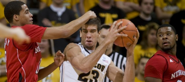 Missouri's Justin Safford, center, looks for help as he is surrounded by Nebraska's Toney McCray, left, Lance Jeter, right, and Brandon Ubel, bottom, during the first half of an NCAA college basketball game Wednesday, Jan. 12, 2011, in Columbia, Mo.