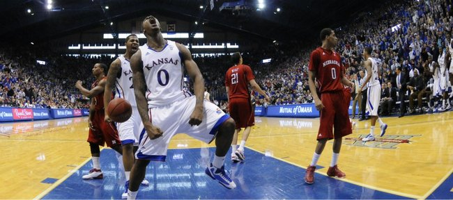 Kansas forward Thomas Robinson roars after a dunk and a foul against Nebraska during the second half on Saturday, Jan. 15, 2011 at Allen Fieldhouse.