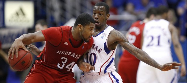 Kansas guard Tyshawn Taylor pressures Nebraska guard Lance Jeter during the first half on Saturday, Jan. 15, 2011 at Allen Fieldhouse.