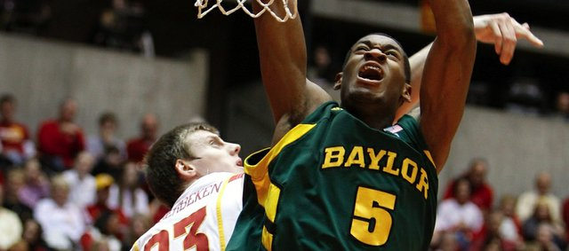 Baylor center Perry Jones (5) drives to the basket past Iowa State forward Jamie Vanderbeken during the first half of their game Saturday in Ames, Iowa. Though he had just 10 points and five boards against the Cyclones, Jones is considered by many to be a possible No. 1 pick in the upcoming NBA Draft. He'll lead the Bears against KU in a Big Monday game tonight in Waco, Texas.