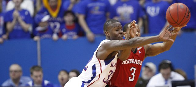Kansas guard Josh Selby knocks the ball away from Nebraska guard Brandon Richardson during the first half on Saturday, Jan. 15, 2011 at Allen Fieldhouse.