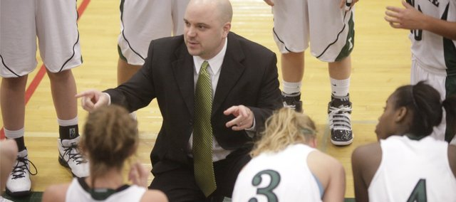 Free State coach Bryan Duncan talks strategy with his Firebirds against the Platte County Pirates on Tuesday, Jan. 4, 2011 at FSHS.