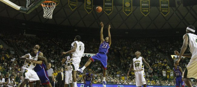 Kansas forward Marcus Morris (22) fades for a bucket in front of the Baylor defense during the first half. Morris had 25 points in the Jayhawks' 85-65 victory over the Bears on Monday in Waco, Texas.