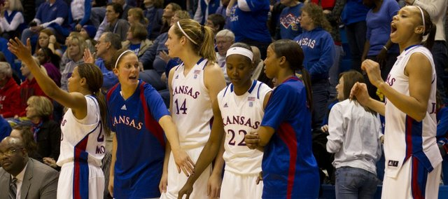 The Kansas bench tries to pump up the crowd during the final seconds of Kansas' game against Texas Tech Saturday in Allen Fieldhouse.