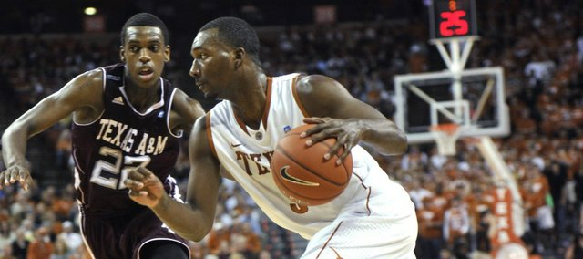 Texas forward Jordan Hamilton, right, drives around Texas A&M forward Khris Middleton, left, during the second half on Wednesday, Jan. 19, 2011, in Austin, Texas. Texas won, 81-60.