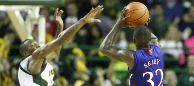 Kansas guard Josh Selby pulls up for a three as Baylor guard LaceDarius Dunn lunges to defend during the second half on Monday, Jan. 17, 2011 at the Ferrell Center in Waco, Texas.