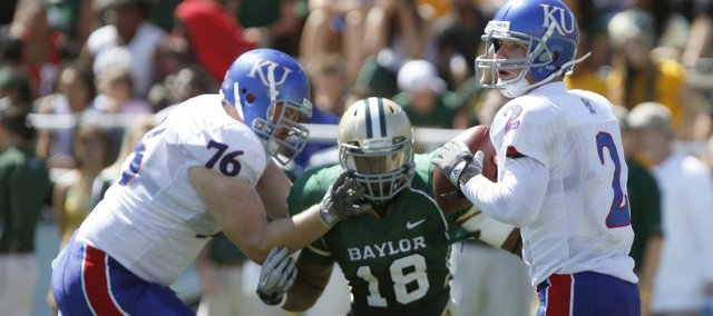 Kansas offensive lineman Brad Thorson (76) fends off Baylor linebacker Tevin Elliott as quarterback Jordan Webb looks to pass on Oct. 2 in Waco, Texas. KU coach Turner Gill has been stressing knockdowns, any legal act by an offensive player that puts a defensive player on the ground.