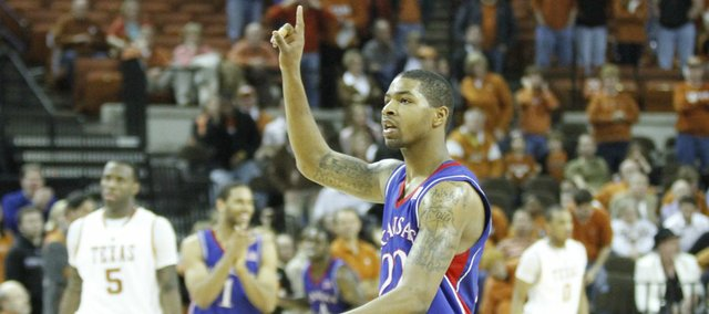 Kansas forward Marcus Morris holds up a number one as the Jayhawks leave the court following their 80-68 win over Texas on Feb. 8, 2010 at the Frank Erwin Center in Austin. The two teams renew their rivalry on Saturday in Allen Fieldhouse.