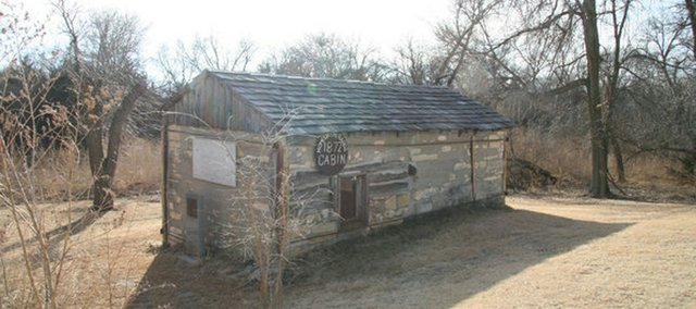 The exterior walls of Dr. Brewster Higley's cabin still stand in Smith County. A rusted buzz saw blade notes 1872, when the cabin was constructed.