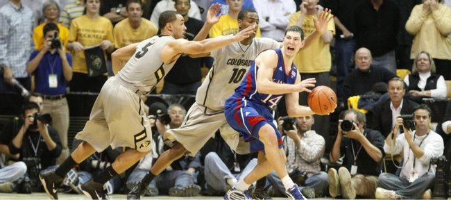 Kansas guard Tyrel Reed breaks through a trap by Colorado defenders Marcus Relphorde (5) and Alec Burks (10) late in the second half Tuesday, Jan. 25, 2011 at the Coors Events Center in Boulder.