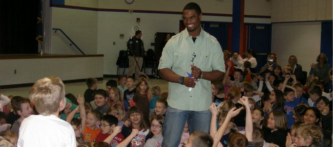 Former Kansas University football safety Darrell Stuckey shares a laugh with students on Wednesday at Oskaloosa Elementary. Stuckey is currently playing in the NFL with the San Diego Chargers.