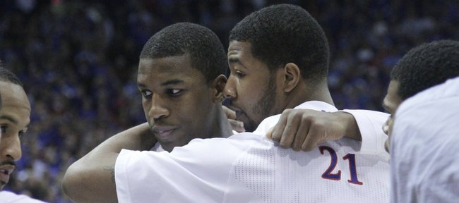 Kansas' Markieff Morris hugs teammate Thomas Robinson before taking on Texas on Saturday, January 22, 2011 in Allen Fieldhouse. Robinson's mother passed away the night before.