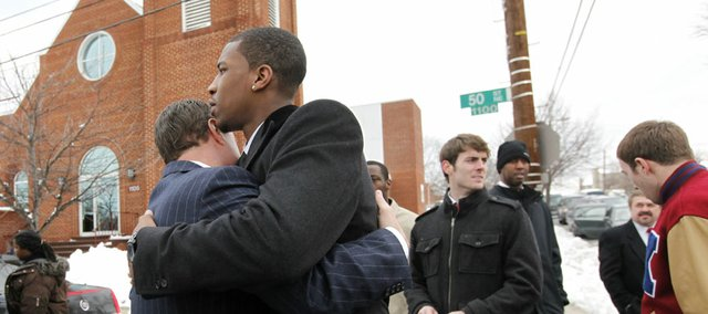 Kansas basketball player Thomas Robinson, right, and KU basketball coach Bill Self, left, embrace following funeral services for Robinson's mother, Lisa Robinson, Thursday, Jan. 27, 2011, at Antioch Baptist Church in Washington.