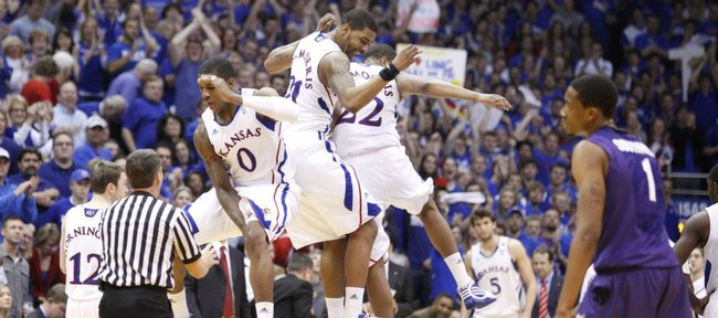 Kansas forward Thomas Robinson gets airborne for a flying bump from the Morris brothers Markieff (21) and Marcus during a timeout against Kansas State during the second half on Saturday, Jan. 29, 2011 at Allen Fieldhouse.