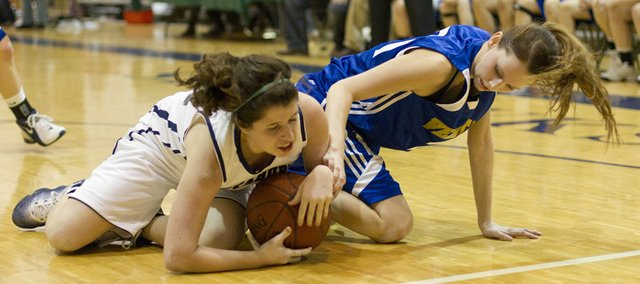 Bishop Seabury sophomore Maddie McCafferey, left, and Veritas junior Kayli Farley fight for possession during Bishop Seabury's game against Veritas Christian School on Friday, Jan. 28, 2011 in Lawrence. The Veritas girls won, 40-18.