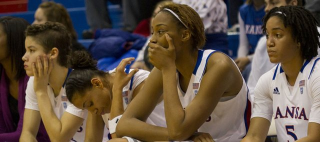 Kansas players, from left, Monica Engelman, Angel Goodrich, Carolyn Davis and Keena Mays watch the closing minutes of KU's game against Baylor Wednesday, Jan. 19, 2011 in Allen Fieldhouse.