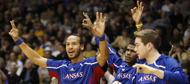 Kansas players Travis Releford, left, Royce Woolridge and Jordan Juenemann celebrate after a pair of free throws by Tyshawn Taylor late in the second half on Tuesday, Jan. 25, 2011 at the Coors Events Center in Boulder.