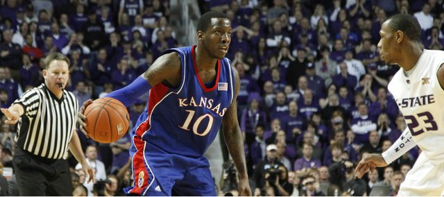 Kansas guard Tyshawn Taylor looks over the Kansas State defense during the second half Saturday, Jan. 30, 2010 at Bramlage Coliseum.