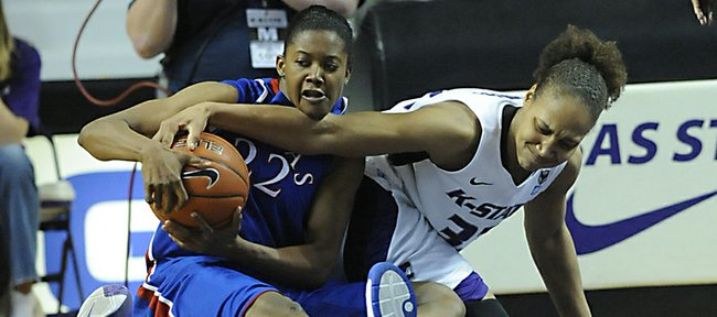 Kansas guard Marisha Brown fights for a loose ball with Kansas State's Alina Voronenko on Saturday, January 29, 2011 in Manhattan.