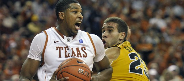 Texas forward Tristan Thompson, left, spins around Missouri forward Justin Safford, right, during the second half Saturday, Jan. 29, 2011, in Austin, Texas. Texas won 71-58.