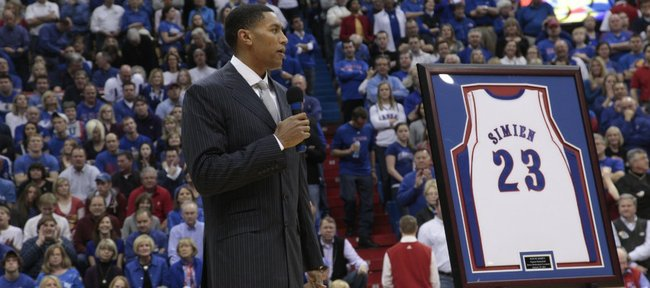 Former Kansas basketball star and Kansas native Wayne Simien watches as his No. 23 jersey is revealed on the south wall at Allen Fieldhouse during a halftime ceremony Saturday, Jan. 29, 2011.