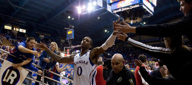 Kansas fans reach out to forward Thomas Robinson as he leaves the court following the Jayhawks' 90-66 win over Kansas State during the second half on Saturday, Jan. 29, 2011 at Allen Fieldhouse. Robinson scored 17 points in his return to the Fieldhouse after Thursday's funeral for his mother, Lisa Robinson, who died last Friday of a heart attack.