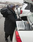 Elisha Friedman packs a new snow shovel into her trunk on Monday, Jan. 31, 2011. Friedman is visiting her mother from New York City.